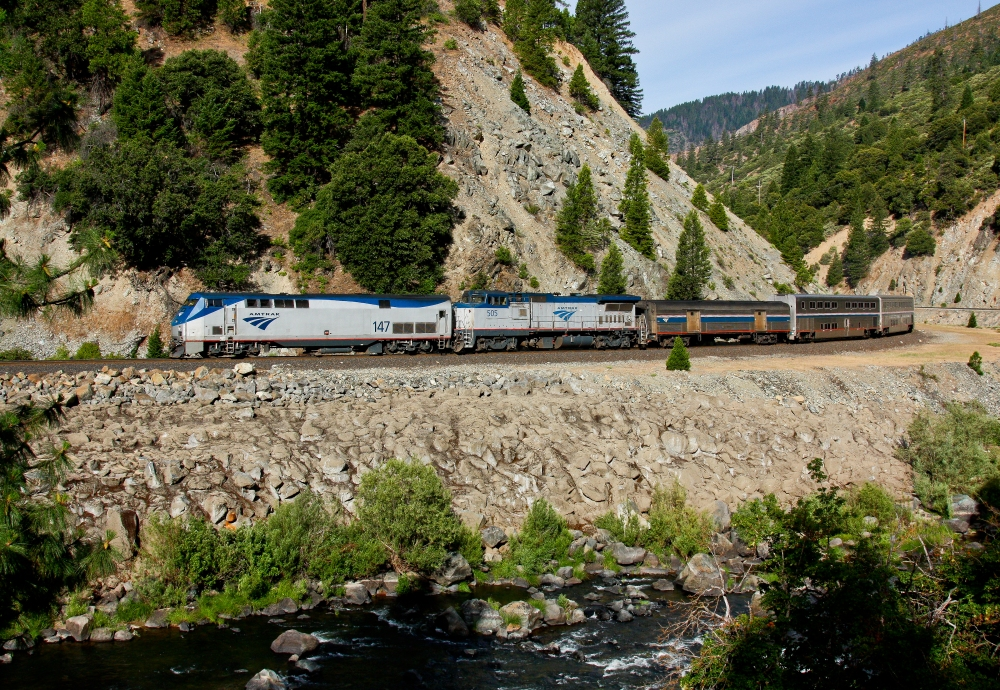 Due to a derailment near Dunsmuir, the northbound Amtrak Coast Starlight made a rare appearance in the Feather River Canyon. Here the train rolls along the banks of the Feather River just east of Belden, California.