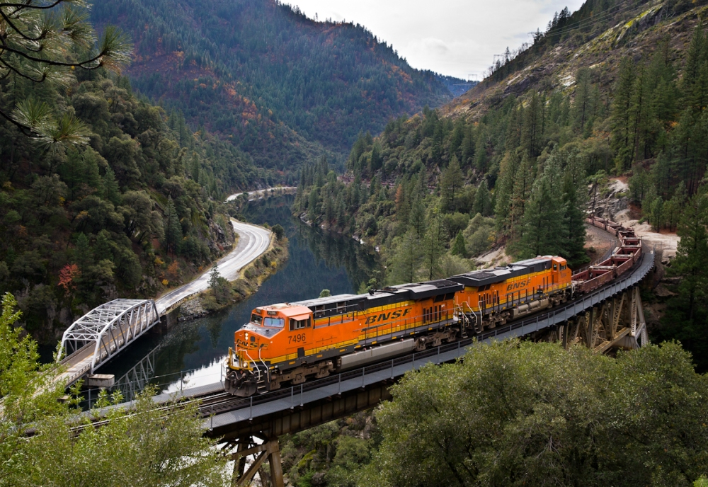 An eastbound BNSF baretable train crosses the Rock Creek Bridge in the Feather River Canyon.