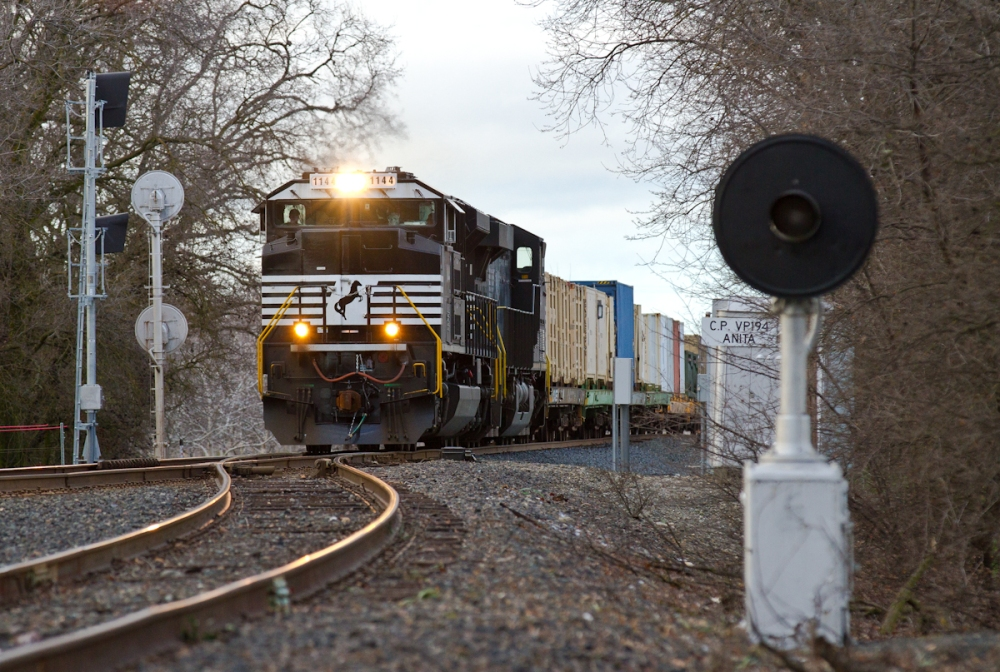 A pair of Norfolk Southern units lead a Union Pacific military train passed the north switch of the Anita Siding (north of Chico). A rare dwarf searchlight has since been removed.
